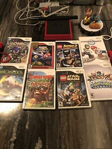 Wii Mini, 2 Controllers and 8 games.