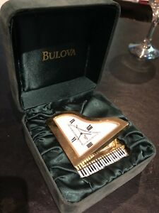 Bulova Mini Baby Grand Piano polished gold vermeil. gbuB0572
