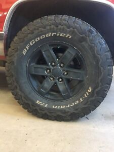 BF Goodrich KO2 tires and rims 6 bolt pattern fits chevy or gmc