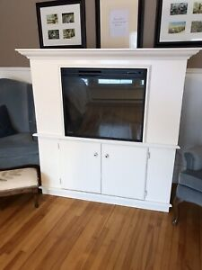 Large Muscoka fireplace with storage underneath