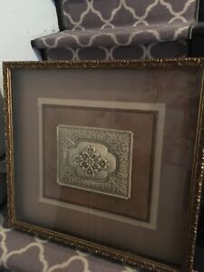 Two gold framed pictures.