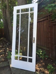 Antique wooden door writ bevelled glass and crystal knob