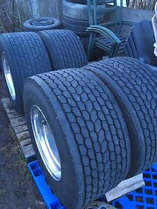 (4) Super Singles on NEW Rims WITH NEW Chains! REDUCED!