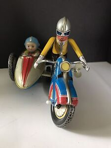1970's Tin Litho Motorcycle with side car wind-up toy