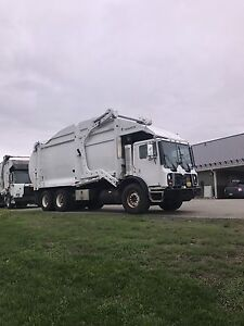 MACK AND AUTOCAR FRONT LOAD GARBAGE TRUCKS