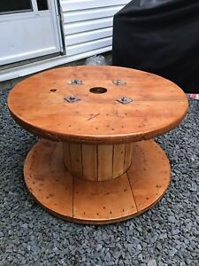 Wooden wire spool turned into a outdoor table