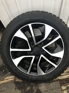 "Four 16"" 5x114.3 Honda wheels and winter tires"