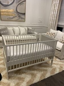 Crib with mattress, wall picture and elephant toy for sale