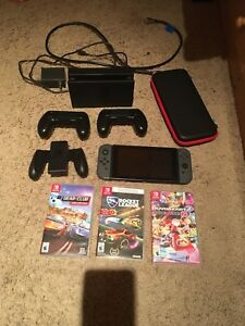 Nintendo switch with 3 games and extras