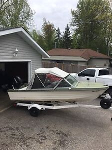 14' fibreglass boat with 25hp mercury  with trailer