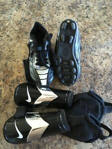 Kids soccer cleats and shin pads