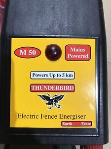 Electric fence energiser 240 V to 12 V with stand-offs and hot tape