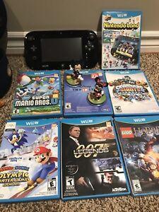 Wii U with 7 games including skylanders & Disney ininity
