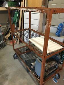 Steel shelf on rollers