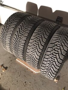 4 Goodyear Nordic winter tires with 4x100 rims (Honda Civic)