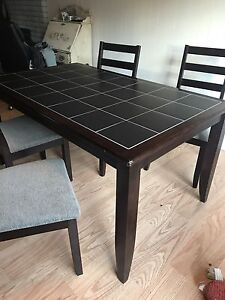 Solid wood dining table with tile top and 4 chairs