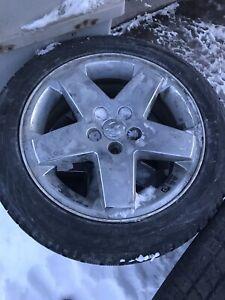 ensemble de pneus ete/hiver en bonne etat