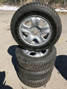 Uniroyal tiger paws 215/70/16 winter tires and rim