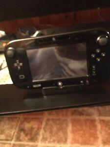 WII U console and 5 games 200 obo