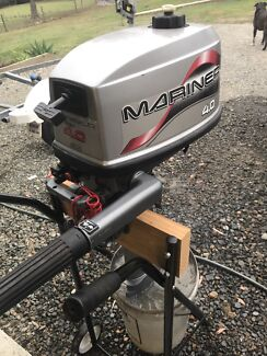 Mariner 4hp outboard motor with engine stand.