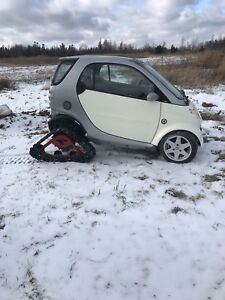 2005 smart car with tracks and skis