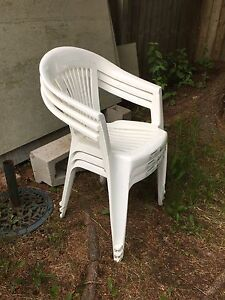 3 white plastic outdoor chairs $20