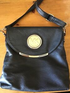 Black cross body with adjustable strap .