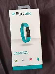 Nearly new FITBIT ALTA WITH EXTRA BAND