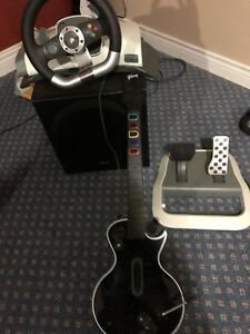 Xbox 360 steering wheel and Guitar hero guitar