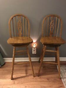 Two bar height swivel stools