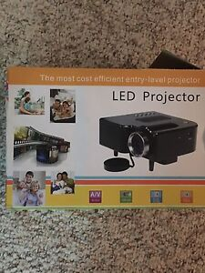 Led projector with screen