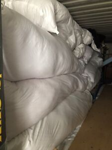 Used blowin in fibreglass insulation in large bags