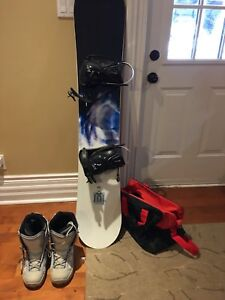 Snowboard and boots and bag
