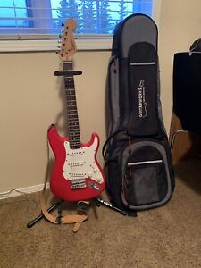 Squier mini electric guitar w/ guitar stand and case