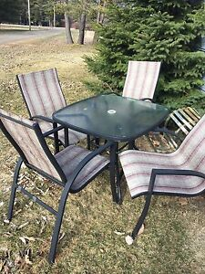 Patio glass table and chairs