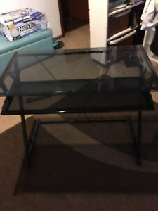 Black glass and metal desk.