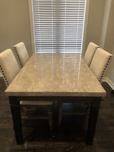Marble Top Dinning Table with 6 chairs.