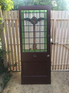 Heavy timber stain glass front door