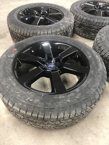 """Factory 20"""" F-150 sport rims with tires"""