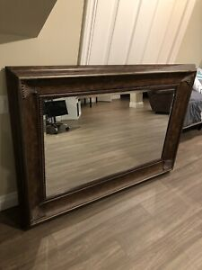 Large mirror with brown frame