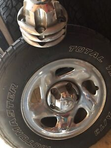 245/70/16 Tires & Chrome Rims with cap centres