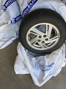 "Four 15"" Pontiac Sunfire rims"