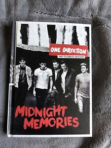 One direction CD and book.