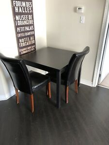 Black kitchen table and 2 leather chairs