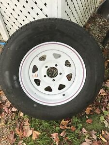 Brand new trailer tire and rim
