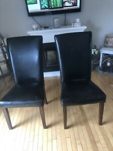 Two black leather Dinning chairs great condition
