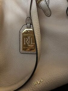 Pink Ralph Lauren purse - used but looks brand new
