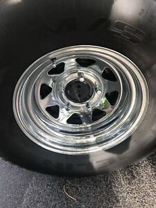 "15"" chrome rims 5x5.5 fits older ford with new tires"