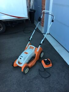 Battery Operated Still Lawnmower with Charger and two Batteries