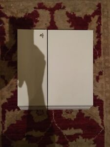 White PS4 (500GB) with controller (blue), cords and 2 games